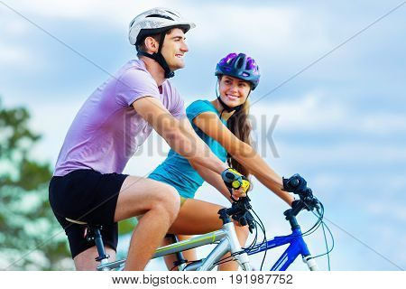 Happy outdoors couple sport leisure activity girl