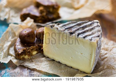 Ancient French Cheese Tomme De Montagne And Dried Figs With Figs Bread