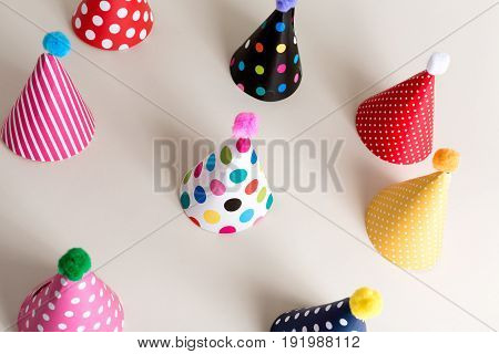 Assorted collection of party hats on an off white background