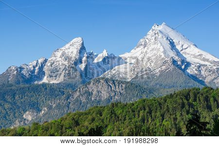 Snowy mount peaks of Watzmann Mountain ridge in Bavarian Alps. Panoramic landscape of German highland national park Berchtesgaden.