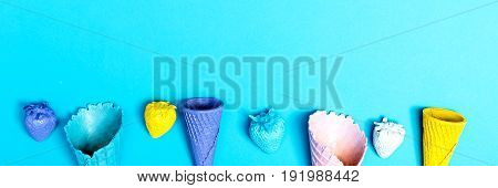 Party theme in blue and purple with streamers and ice cream cones