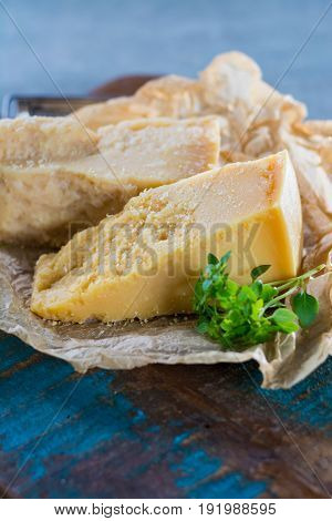 Traditional Italian Hard Cheese Parmesan And Grana Padano With Grater And Fresh Basil
