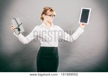 Businesswoman holding document and tablet. Choice between digital and physical data storage. Woman with padlock chained file and pc computer.