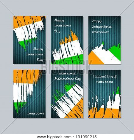 Ivory Coast Patriotic Cards For National Day. Expressive Brush Stroke In National Flag Colors On Dar