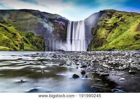 Long Exposure Of Famous Skogafoss Waterfall In Iceland At Dusk