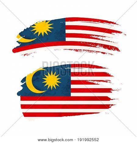 Grunge brush stroke with Malaysia national flag isolated on white