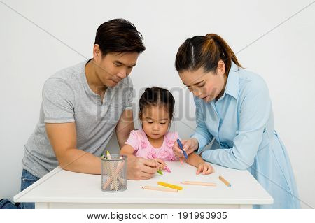 Parents and Daughters are helping to paint.