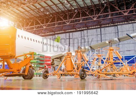 Racks, A Jack In The Hangar And The Plane Is Under Repair.