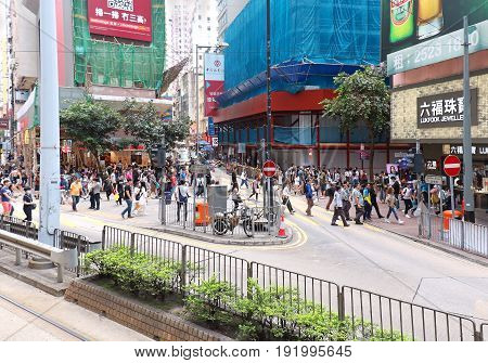 HONG KONG CHINA - APRIL 29; Yee Wo Street on Hong Kong Island with many pedestrians crossing the road in Hong Kong China - April 29 2017: Yee Wo Street junction with Hennessy Road is one of the busiest junctions in Hong Kong