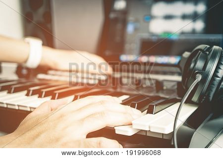 Musician is recording Music on Desktop studio