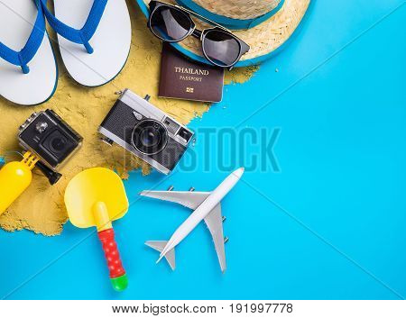 Summer Beach Vacation travel equipment and fashion on blue copy space