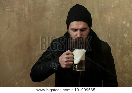 Bearded Man Drinking Beer From Glass Mug