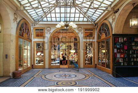 PARIS, FRANCE - June 14, 2017: Galerie Vivienne is an ancient historical passage with shops and restaurants and a tourist attraction in Paris in France