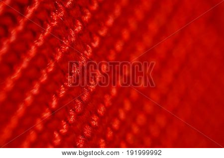 Red nylon belt close-up. Shallow depth of field. The interweaving of the fibers in the belt texture as abstract background