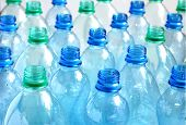 Many empty blue and green water bottles. Shallow DOF. poster
