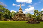 Wat Chang Lom temple and white clound in Sisatchanalai Historical Park Sukhothai province Thailand poster