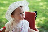 An Infant Toddler Girl dressed as Betsy Ross for Fourth of July Parade poster