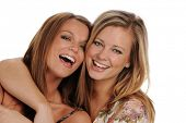 Two Young beautiful Sisters smiling isolated on a white background poster