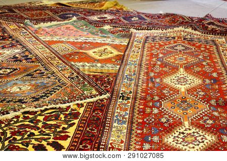 Persian Carpets In Yazd, Iran. Carpet Weaving Is An Essential Part Of Persian Culture And Iranian Ar