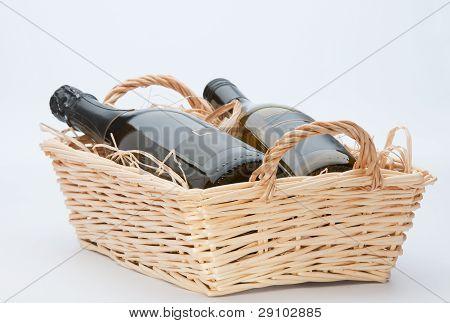 Wine Bottles In Basket.