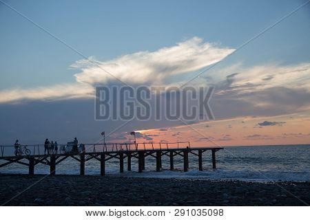 Sun Setting Over Terrace Dock Or Pier. Dock (pier) Sea And Cloudy Sky Background. Sunset