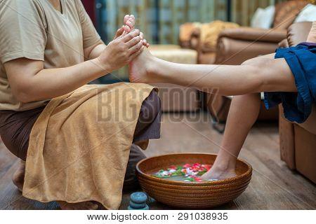 ํyoung Woman Having Feet Massage In Beauty Salon, Pedicure And Foot Massage, Woman In A Beauty Salon