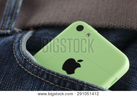 Tambov, Russian Federation - October 16, 2013  Apple Iphone 5c Green Color In A Pocket Of Jeans. Stu
