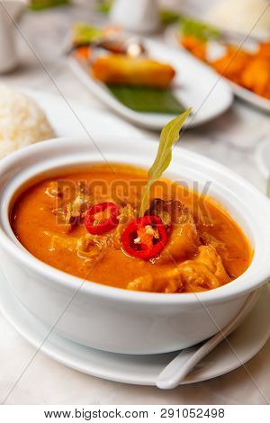 Massaman Duck Curry Served In Bowl At Restaurant