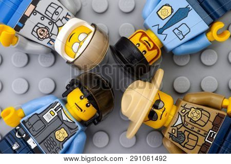 Tambov, Russian Federation - May 12, 2016 Four Lego Policemen Minifigures On Lego Gray Baseplate Bac