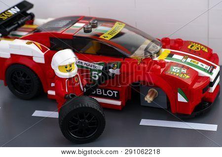 Tambov, Russian Federation - March 18, 2015 Lego Driver Minifigure Is Fixing Wheel Of  Ferrari 458 I