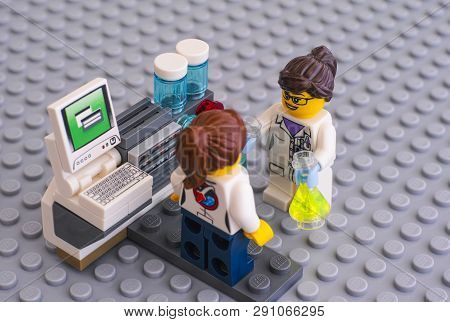 Tambov, Russian Federation - June 10, 2015 Two Lego Scientist Minifigures Near Laboratory Computer O