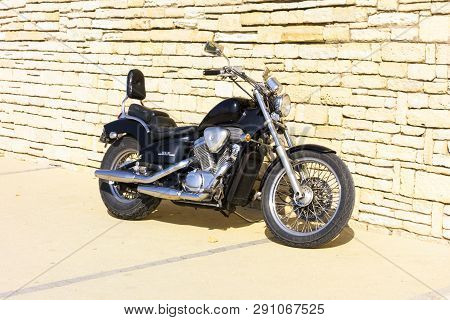 Paphos, Cyprus - November 01, 2013 Motorcycle Honda Steed Vlx Standing Near Brick Wall.