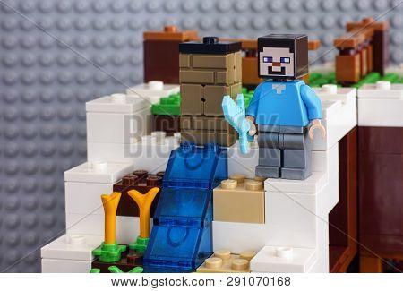 Tambov, Russian Federation - June 25, 2017 Lego Minecraft. Steve Minifigure With Diamond Sword Stand