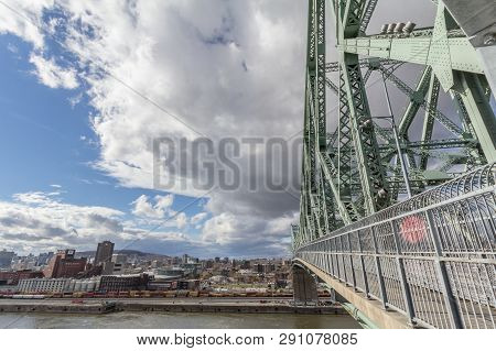 Montreal, Canada - November 8, 2018: Jacques Cartier Bridge With The Molson Brewery In Background. I