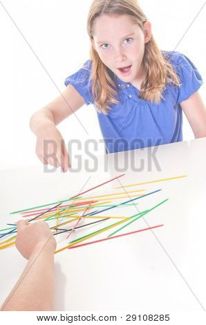 Kids playing old fashioned stick game