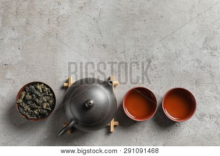 Flat Lay Composition With Cups Of Tie Guan Yin Oolong Tea And Space For Text On Grey Background