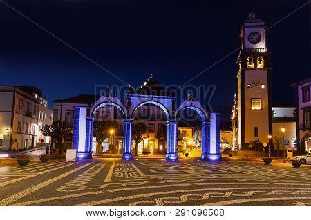 Night Scene Of Ponta Delgada Main Square With Portas Da Cidade - City Gate And Saint Sabastian Churc