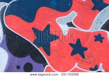 Fragment Of Graffiti Drawings. The Old Wall Decorated With Paint Stains In The Style Of Street Art C