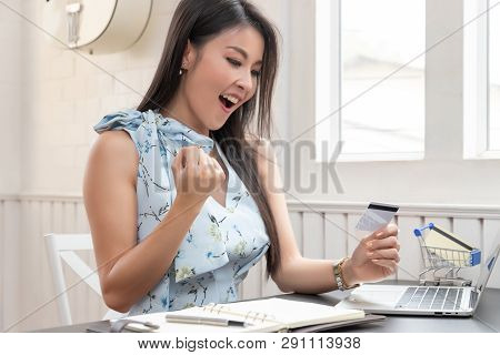 Freelancer Business Woman Using Computer Laptop And Credit Cart To Shopping Online In Cafe.