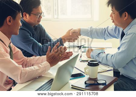 Business And Finance Concept Of Office Working,teamwork Of Businessmen Shaking Hand After Deal Inves