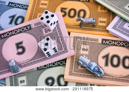 Tambov, Russian Federation - January 26, 2018 Monopoly Money Packs With Tokens And Dice. Full Frame.