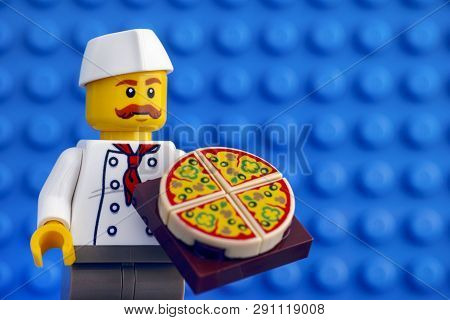 Tambov, Russian Federation - February 05, 2018 Lego Chef With Pizza Against Blue Baseplate Backgroun