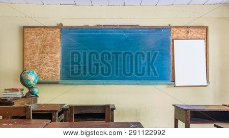 Vintage Retro Classroom Interior With Empty Chalkboard For Your Copy Space. Education And School Bac