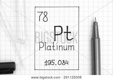 The Periodic table of elements. Handwriting chemical element Platinum Pt with black pen, test tube and pipette. Close-up. poster