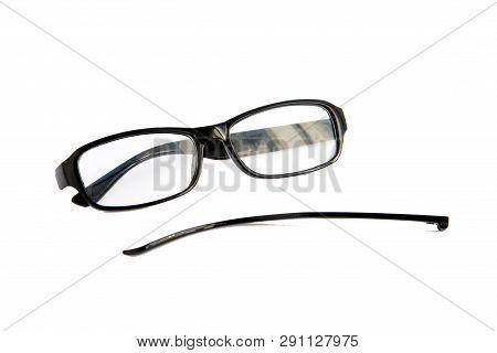 Broken Eye Glasses, Isolated On White Background. Black Celluloid Frame. Grief Smiley.