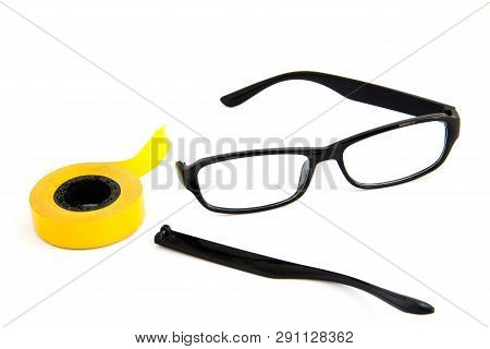 Broken Eye Glasses, Isolated On White Background. Black Celluloid Frame And Scotch Tape.