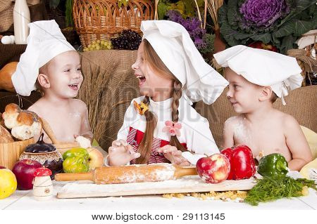 Children In A Chef's Hats Smiling