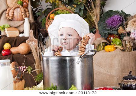 Cute Boy Wearing A Chef Hat Sitting Inside A Large Cooking Stock Pot
