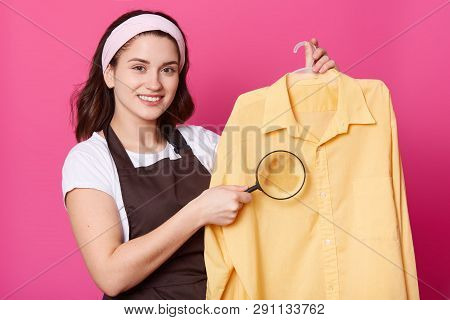 Studio Shot Of Pleasant Looking Housewife With Pleasent Look, Wears White Hair Band, Casual T Shirt,