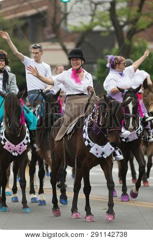 Louisville, Kentucky, Usa - May 03, 2018: The Pegasus Parade, Women Riding Horses Down W Broadway, D